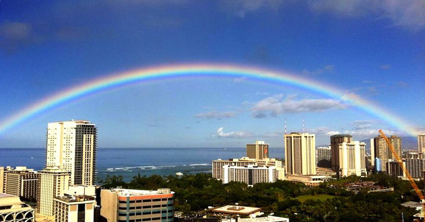 Hawaiian rainbow over Waikiki beach With Our Aloha