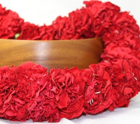 carnation leis in red
