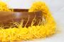 bright yellow flower lei