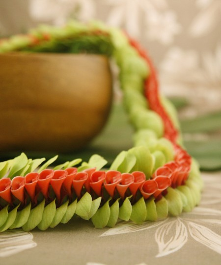 red and green orchid lei