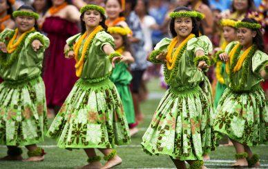hula dancers with Hawaiian flowers leis