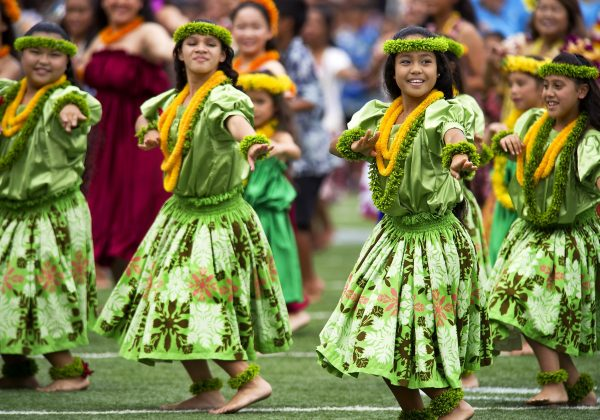 hula dancers with Hawaiian flowers leis